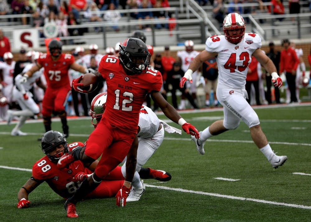<p>Sophomore wide receiver Justin Hall runs the ball up the field against Western Kentucky Sept. 22, 2018, at Scheumann Stadium. Hall had 60 receiving yards. Rebecca Slezak,DN</p>