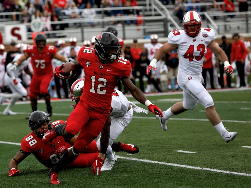 Sophomore wide receiver Justin Hall runs the ball up the field against Western Kentucky Sept. 22, 2018, at Scheumann Stadium. Hall had 60 receiving yards. Rebecca Slezak,DN