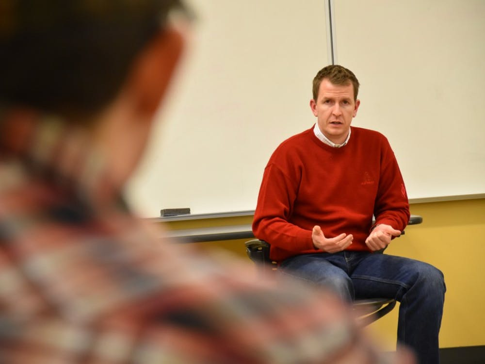 Adam Berry, a co-founder of PoliticalBank, speaks to a member of the Ball State College Republicans on Feb 9. He worked with Mike Pence during his campaign in the gubernatorial race and as a regulatory policy director in Pence's administration. Patrick Calvert // DN Photo