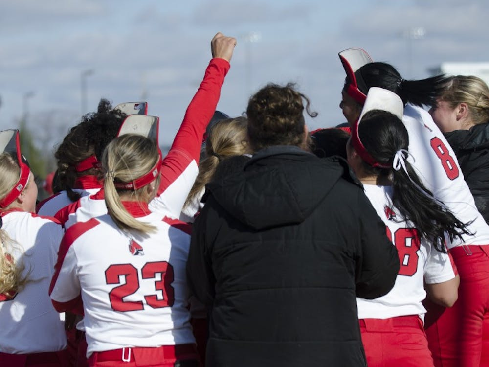 Ball State meets senior center fielder Rachel Houck at homeplate after she hit a walk-off homerun during the second game of the double-header against Miami University on April 1 at the First Merchants Ballpark Complex. Ball State won the game 3-1. Emma Rogers // DN