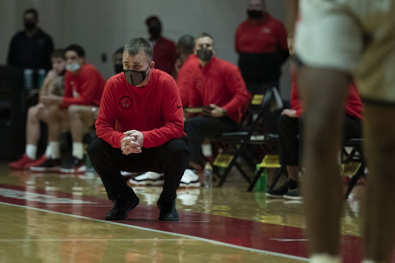 Ball State Cardinals head coach James Whitford squats down and watches the game in the first half agains the Northern Illinois Huskies Jan. 16, 2020, at John E. Worthen Arena. The Cardinals beat the Huskies 78-58. Jacob Musselman, DN