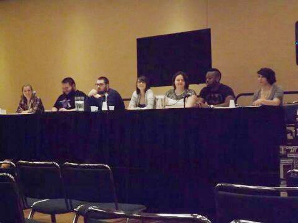 Fourteen Ball State students are taking an immersive learning class called Representing Religion in Comics. The class, taught by Associate Professor of Religious Studies Jeffrey Brackett, attended the Indianapolis Comic Con on March 15 as a panel speakers. PHOTO PROVIDED BY VAJAUN GREENE
