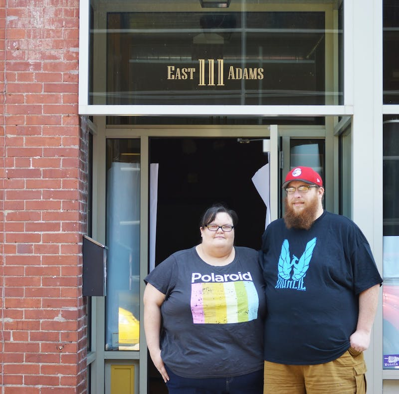 Ball State alumnus Andy Shear and his wife Amy work daily to finish setting up their new store at 111 E. Adams St. Both hope to welcome guests and join the Muncie community Sept. 6. Tier Morrow, DN