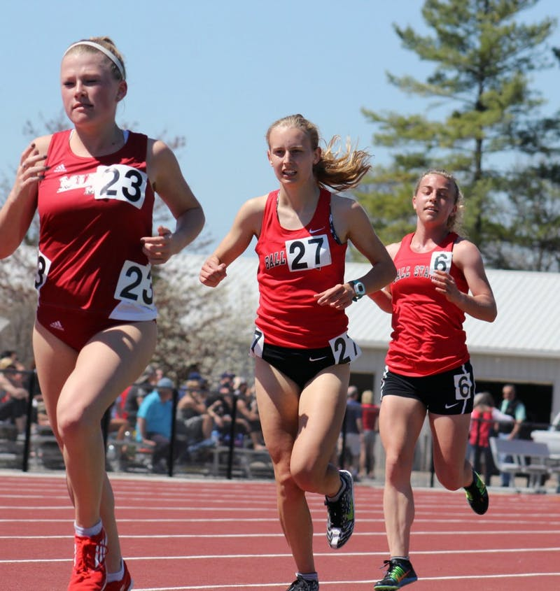 Freshmen Jessica Bryzek (left) and Kitty Taylor compete in the women's 5,000 meter run at the Ball State Challenge at the Briner Sports Complex on Saturday, April 16, 2016. DN PHOTO ALLYE CLAYTON