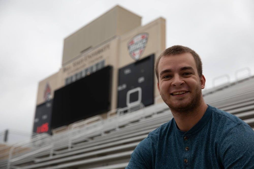 <p>Zach Piatt smiles for a portrait Sept. 23, 2020, at Scheumann Stadium. Piatt has covered 26 Ball State Football games as a student. <strong>Jacob Musselman, DN</strong></p>