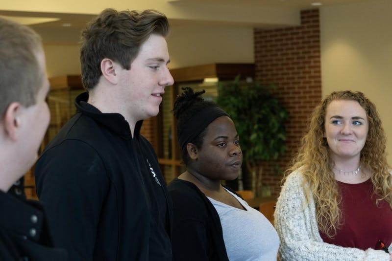 "Senators Marcus Jennings, Justin Plowdrey, Lilly Owsley and Emily Lahey listen to students at the Atrium Oct. 16 during SGA's ""blitz"" event, during which senators talk to students to assess their needs. Some of the more popular student issues were parking, the Health Center's services and bus loop additions or changes. John Lynch, DN."