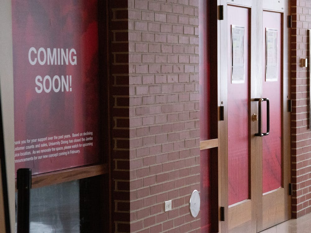 "A ""Coming Soon"" window sign sticks to the window outside of the former Jamba Juice entrance Feb. 8, 2021, in the Atrium. The new cafe and convenience store is expected to open Feb. 15. Grace Walton, DN"