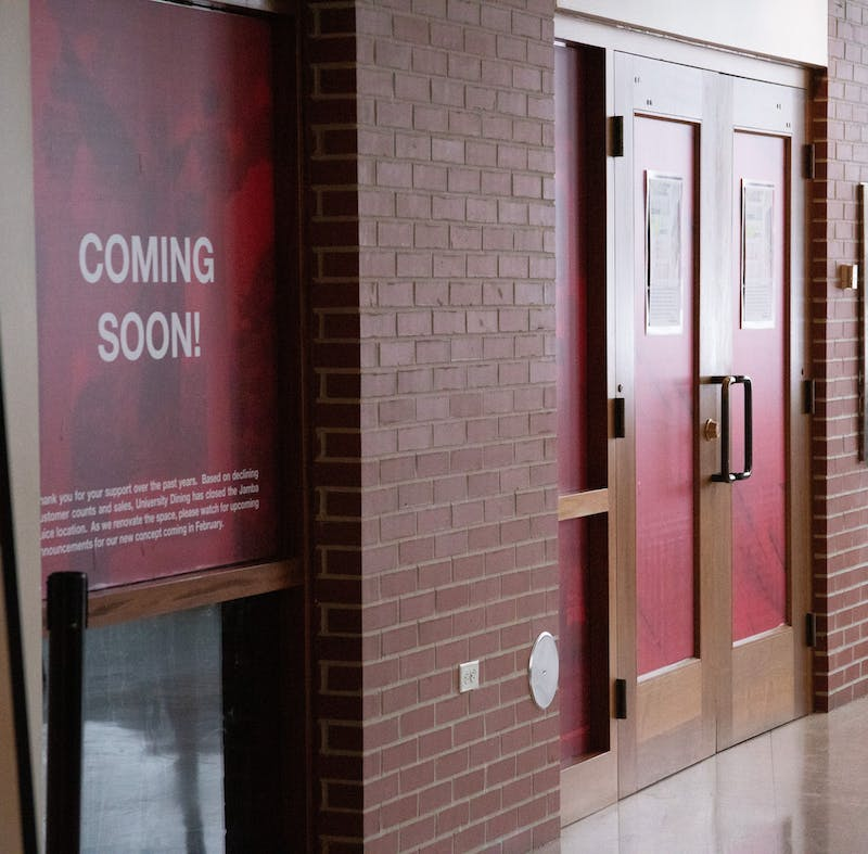 """A """"Coming Soon"""" window sign sticks to the window outside of the former Jamba Juice entrance Feb. 8, 2021, in the Atrium. The new cafe and convenience store is expected to open Feb. 15. Grace Walton, DN"""
