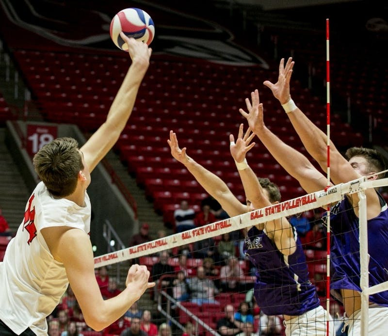 Sophomore outside attacker Matt Szews spikes the ball during the MIVA Tournament Quarterfinals April 14 in John E. Worthen Arena. Szews had 10 kills throughout the three sets. Kaiti Sullivan, DN