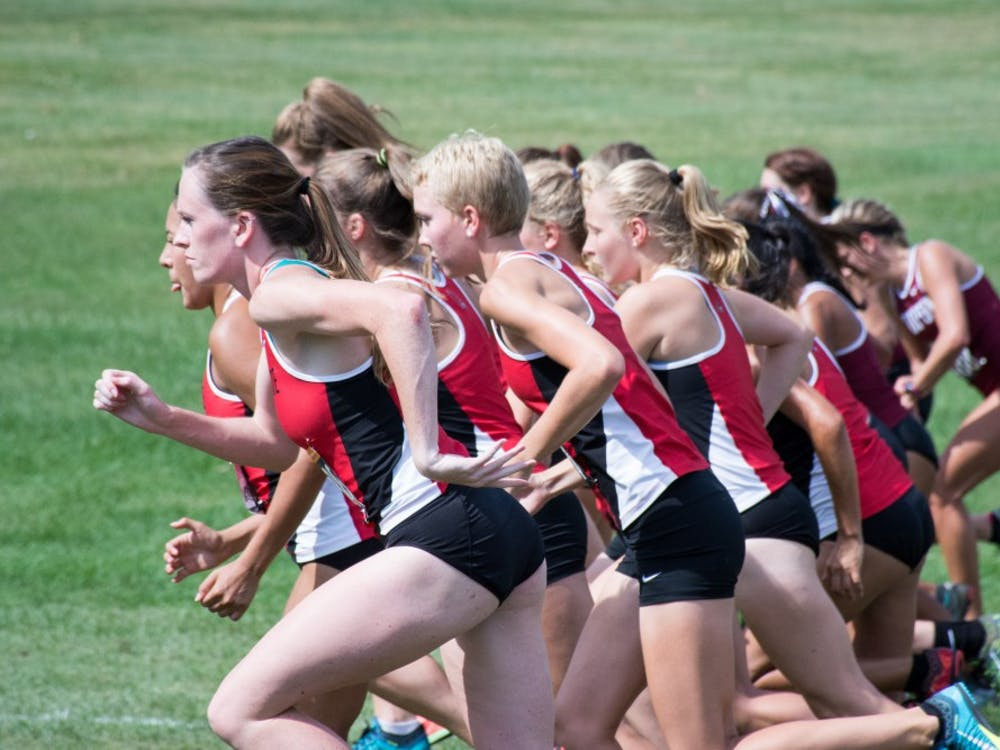 Team members take off at the start of the cross country meet against IUPUI on Sept. 23, 2016 at the Muncie Elks Country Club.  Ball State won against IUPUI 16-46. Kaiti Sullivan // DN