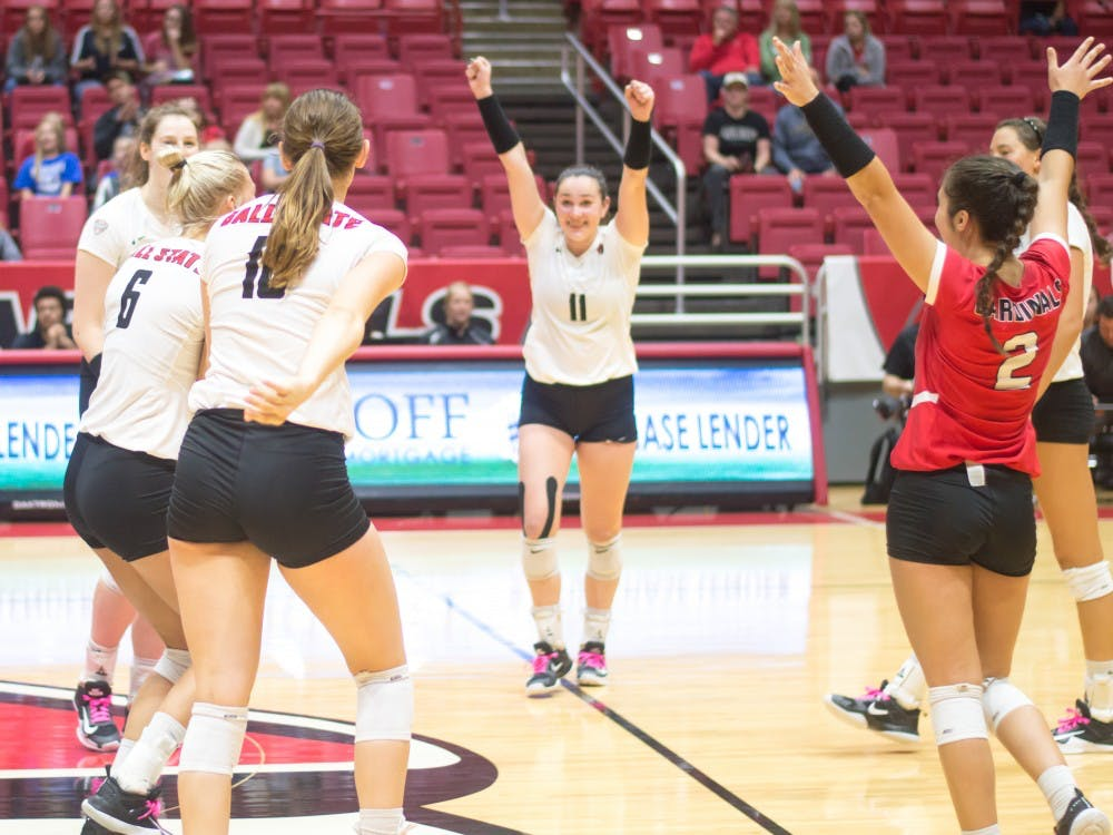 Ball State's women's volleyball team celebrate after scoring against Western Michigan on Oct. 6 in John E. Worhen Arena. The Cardinals won 3-1. Terence K. Lightning Jr., DN