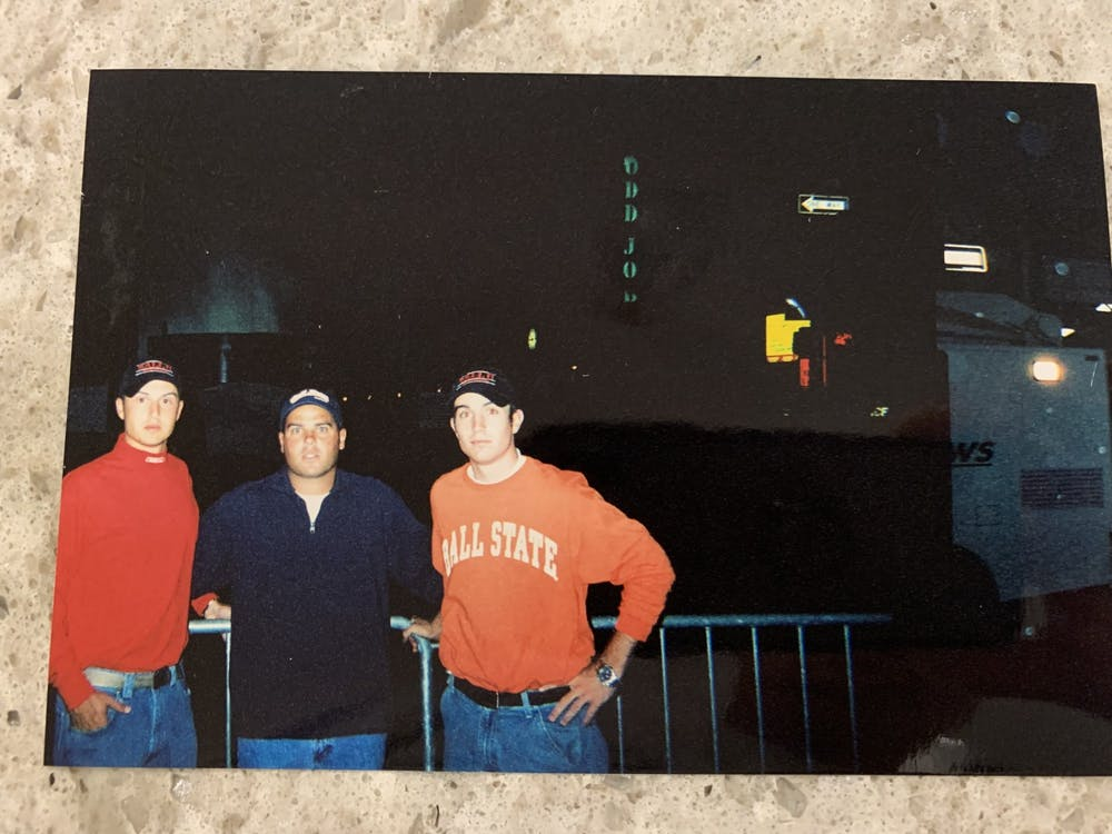<p>Nathan Vannatter (left), Mike Fleck (middle) and Lance Scholl (right) stand next to a police car near the site of where two planes crashed into the World Trade Center Sept. 11, 2001. <strong>Nathan Vannatter, provided. <br/></strong><br/></p>