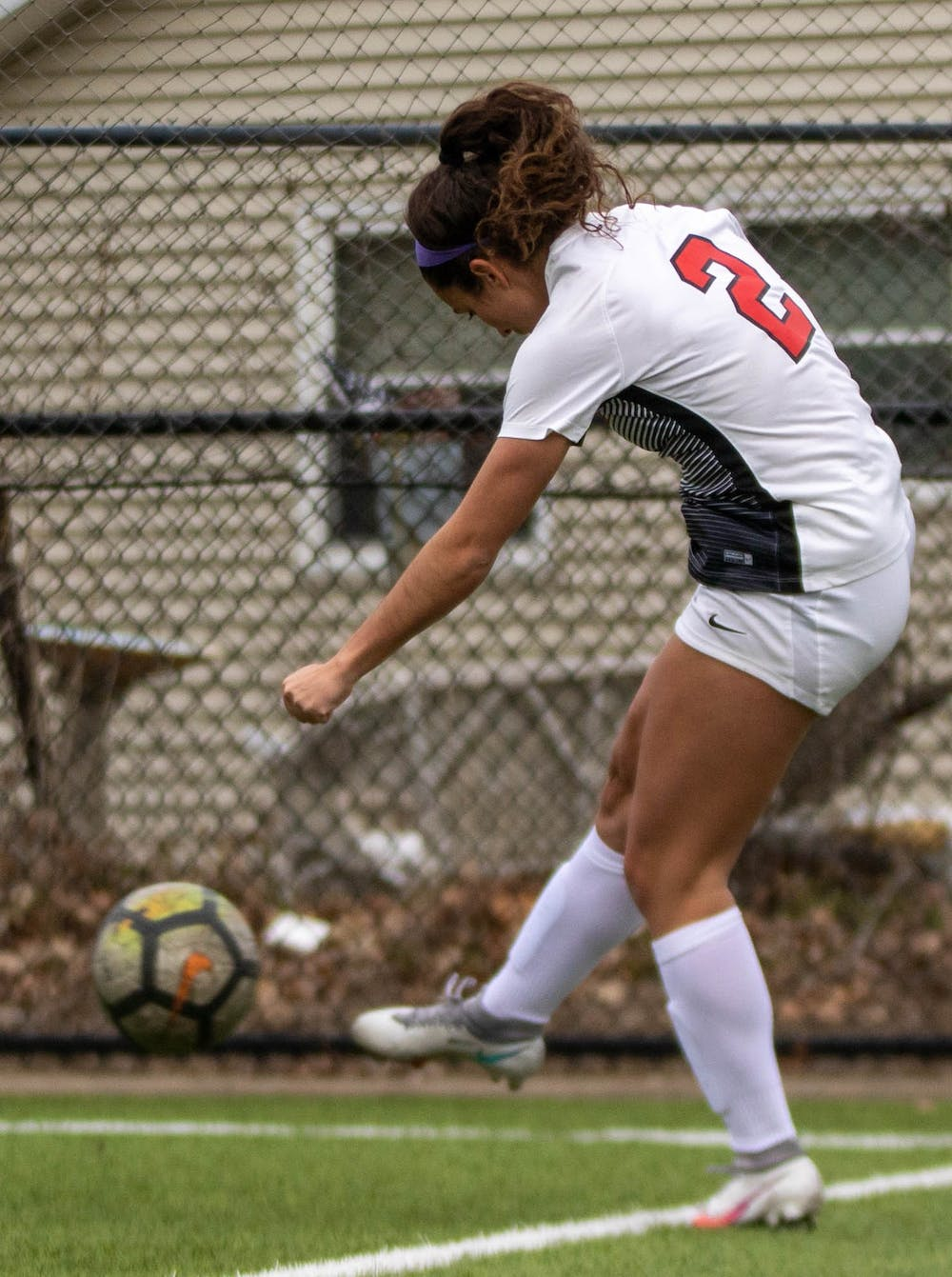 Redshirt junior Lizzie Philiban saves the ball from going out of bounds March 12, 2021, at Briner Sports Complex. The Cardinals tied at zero in double overtime against the Broncos. Jaden Whiteman, DN