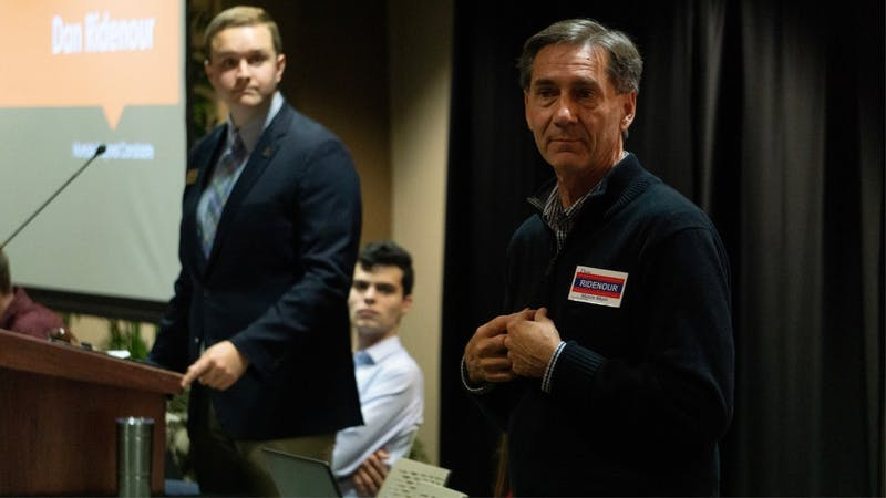 Muncie mayoral candidate Dan Ridenour (R) speaks to the SGA senate as vice president Cameron DeBlasio looks on. Ridenour said his campaign would focus on fighting nepotism and improving government transparency during his speech. John Lynch, DN.