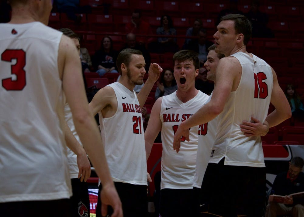 <p>Freshman Ryan Dorgan cheers as Ball State Cardinals win consecutive points in the end of the third game at John E. Worthen Arena on March 31 against Quincy Hawks. The Ball State Cardinals won all 3 games played. <strong>Rebecca Slezak, DN</strong></p>