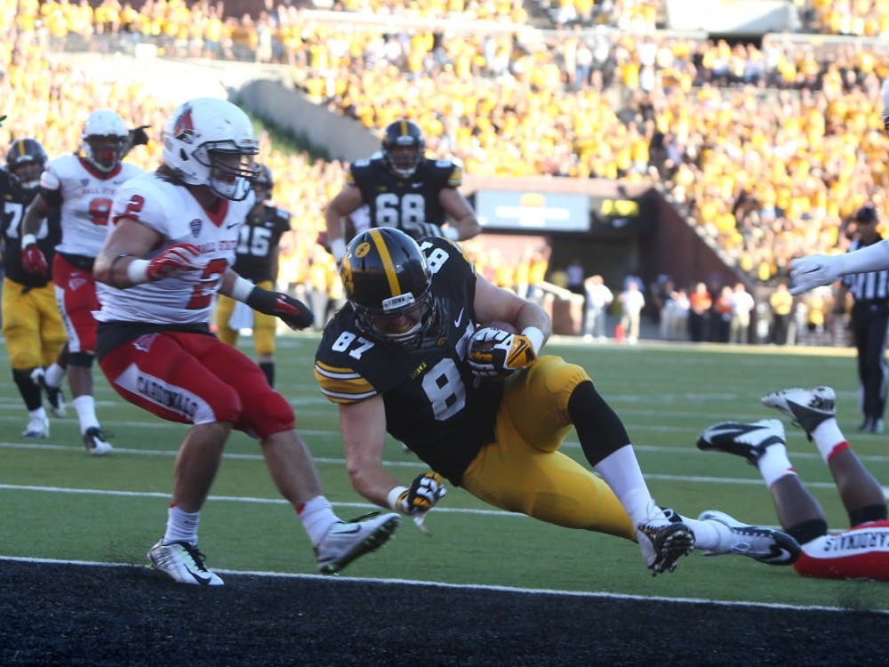 Iowa tight end Jake Duzey scores a touchdown in the last moments of the game in Iowa on Sept. 6. Iowa defeated Ball State, 17-13 because of this play. PHOTO PROVIDED BY TESSA HURSH THE DAILY IOWAN