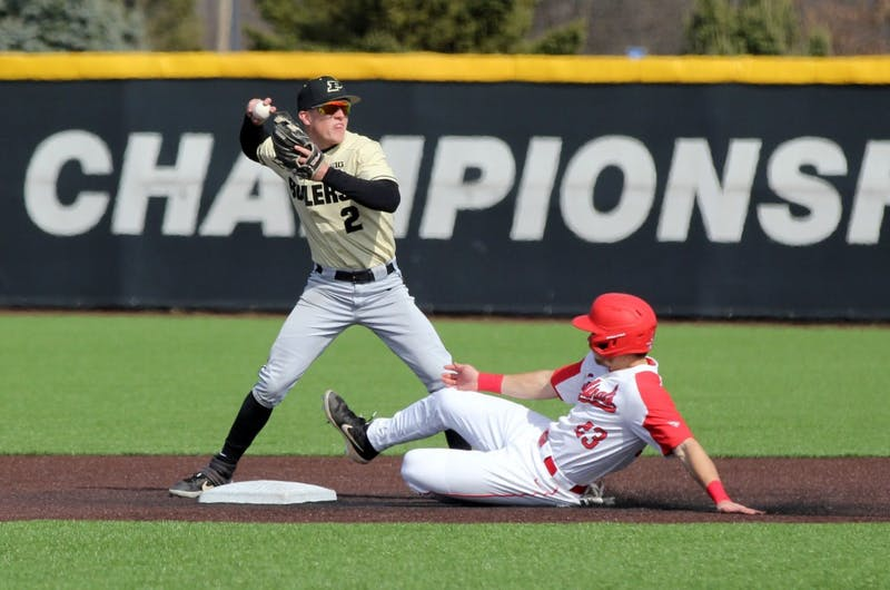 Purdue second baseman Tyler Powers throws the ball to first as Ball State junior Ross Messina slides into second for a double play in the third inning of the Cardinals game against the Boilermakers March 19 at Ball Diamond at First Merchant's Ballpark Complex. Ball State won 6-0. Paige Grider, DN