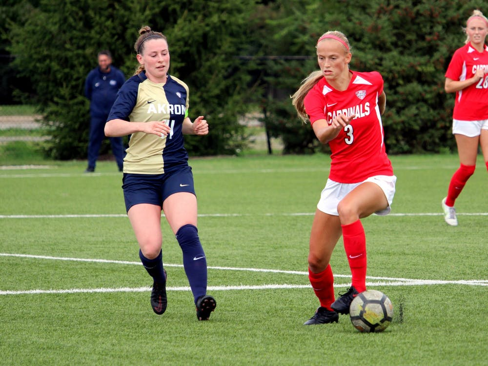 Senior defender Lexy Smith goes for the ball against Akron on Oct. 3, 2021, at Briner Sports Complex in Muncie, IN. Amber Pietz, DN