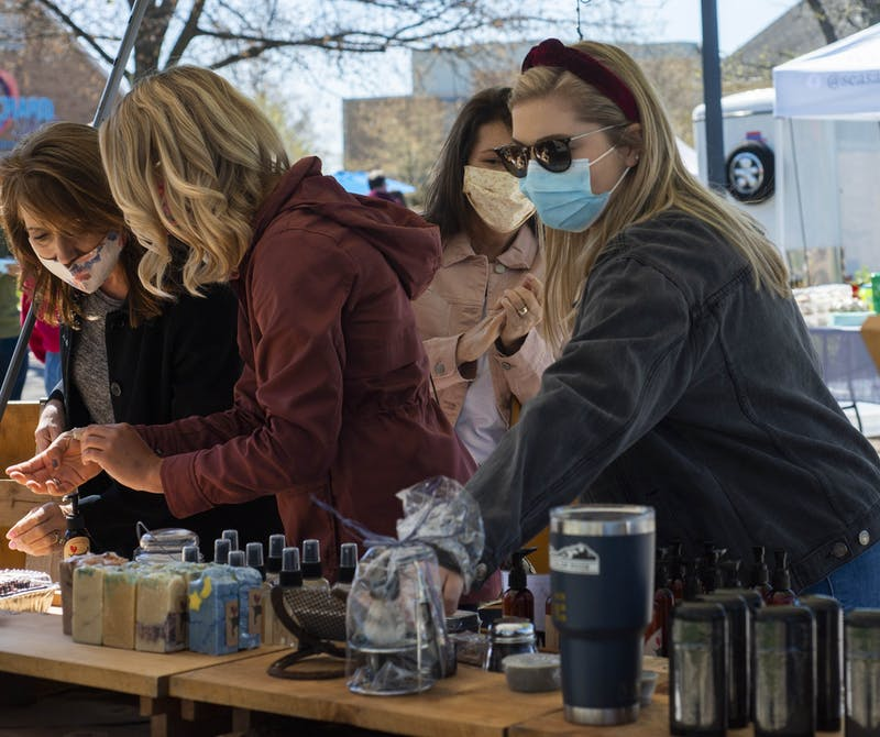 Minnetrista Farmers Market customers browse vendors' products May 8, 2021. Catherine Reynolds, Minnetrista Farmers Market manager, said she expects about 3,000 people per week to visit the market this summer. Breanna Daugherty, Photo Provided