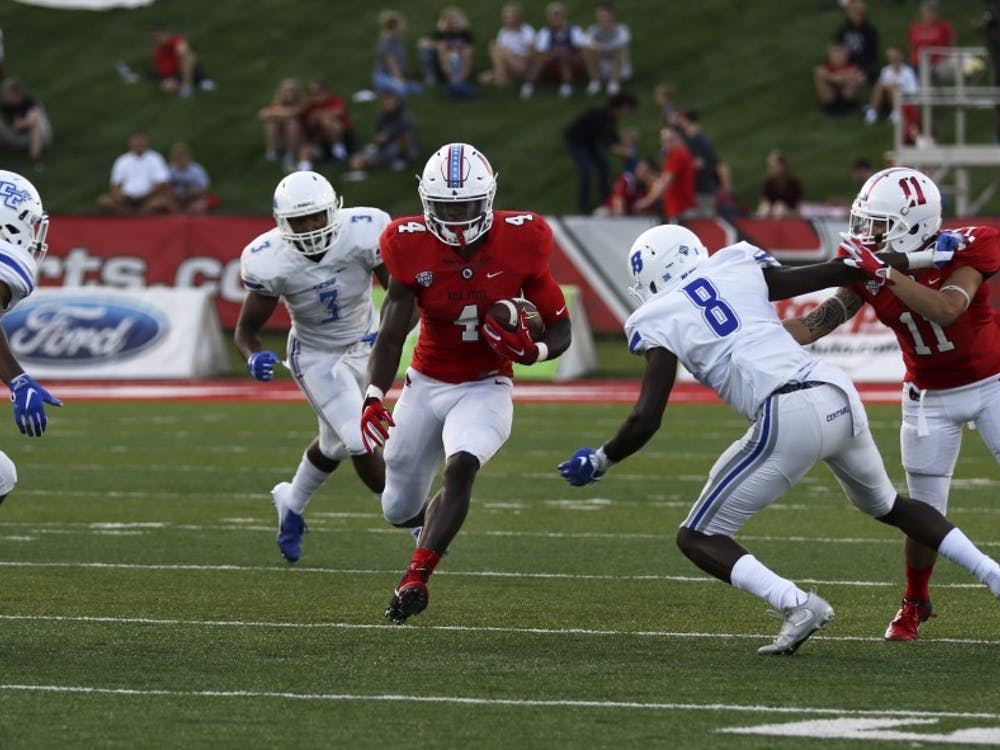 Then-junior running back Malik Dunner runs past Central Connecticut State players during Ball State's game against the Blue Devils Aug. 31, 2018, at Scheumann Stadium. Dunner had 51 rushing yards in the game. Paige Grider, DN