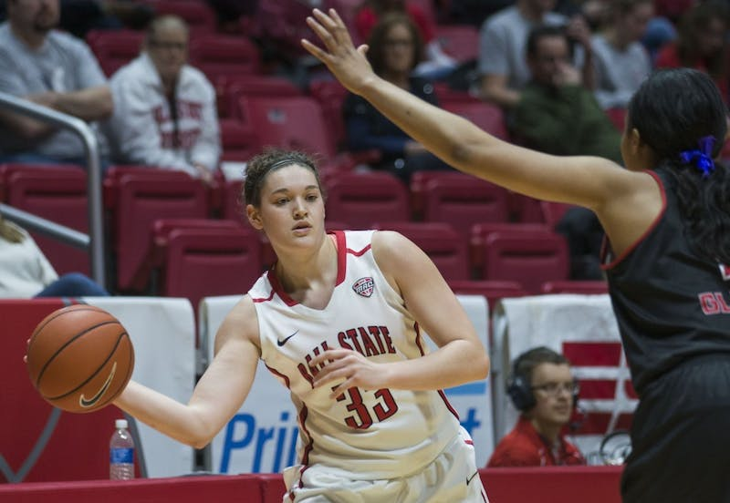 Junior forward Moriah Monaco attempts to pass the ball at the game against Northern Illinois University on Jan. 28 in Worthen Arena. The cardinals lost 101-96. Breanna Daugherty // DN