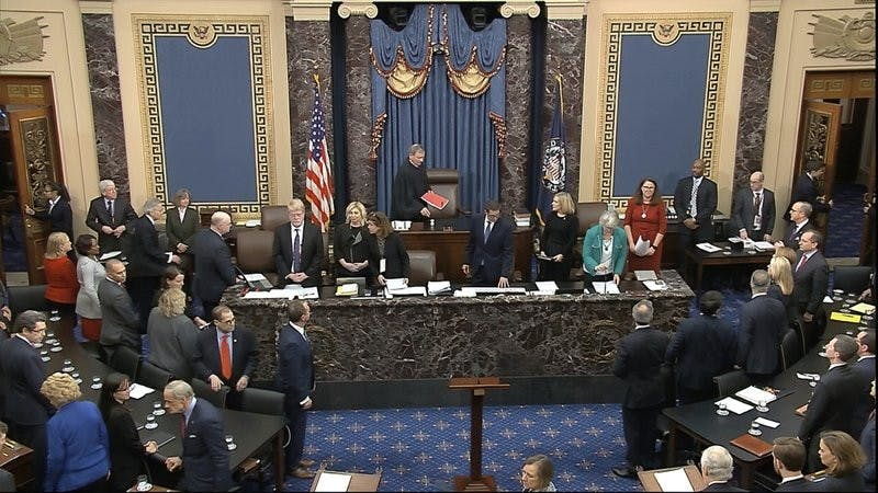 In this image from video, Chief Justice of the United States John Roberts arrives for the vote in the impeachment trial against President Donald Trump in the Senate at the U.S. Capitol in Washington, Wednesday, Feb. 5, 2020. (Senate Television via AP)