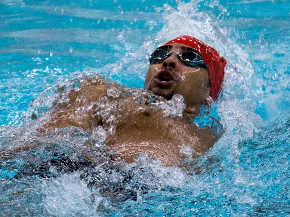 Sophomore Chase Jackson competes the 200-yard backstroke during the meet against Miami Feb. 10 at Lewellen Pool. The team has an all-time record of 341-245-3. Eric Pritchett, DN