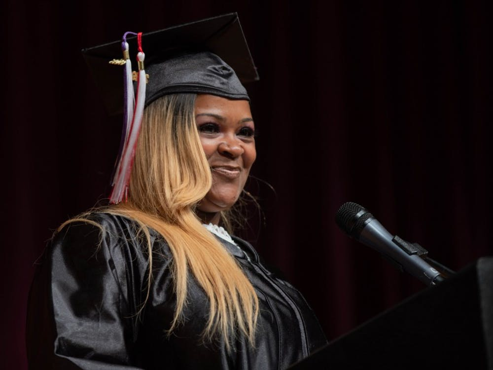 Angela Bennett smiles while giving her speech at the Adult Education Program Class of 2019 Graduation in the Muncie Central  High Auditorium May 9, 2019. Bennett battled addiction for 13 years. Scott Fleener, DN