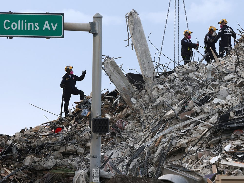 Search and rescue operations resume as members of the Pennsylvania Search and Rescue team comb through the debris several after hours after the Champlain Tower South complex was demolish on Monday, July 5, 2021 in Surfside, Florida. (Carl Juste/Miami Herald/TNS)