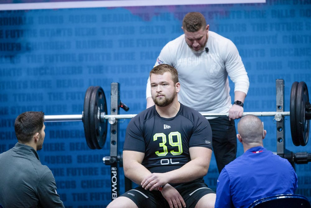 <p>Danny Pinter gets lose before starting the bench press drill Feb. 27, 2020, at the Indiana Convention Center in Indianapolis. Pinter put up 24 reps during the drill. <strong>Jacob Musselman, DN</strong></p>