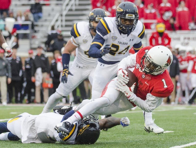 Sophomore wide recover Jordan Hogue gets tackled during the game against Toledo on Oct. 2 at Scheumann Stadium. DN PHOTO BREANNA DAUGHERTY