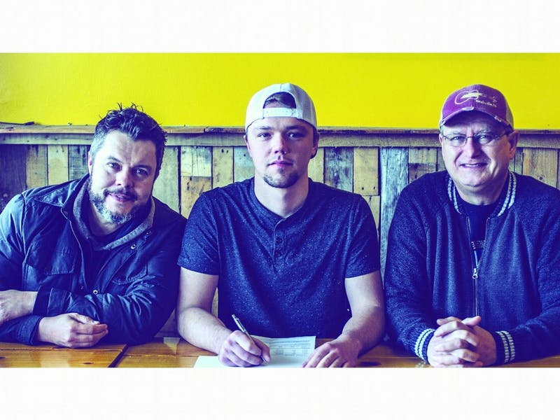(Left to Right) Jason Wyatt, CEO of Nashville Artist Development, Paul Rosewood and Keith Mohr, NAD team members pose for a picture as Rosewood signs at NAD in March. Rosewood has been a lover of music since he was a child. Paul Rosewood, Photo Provided