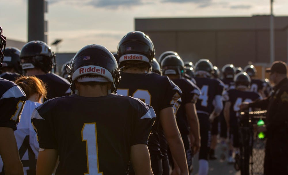 <p>The Delta Eagles walk toward their locker room before the start of their game with the Muncie Central Bearcats Aug. 23, 2019. The Eagles won the game, 42-0. <strong>Jacob Musselman, DN</strong></p>