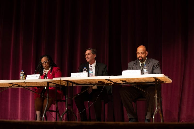 The three Muncie mayoral candidates, (left to right) Terry White Bailey, Dan Ridenour and Steve Smith answered questions from the audience, Sept. 26, 2019, at the Muncie Central Auditorium. Panelists had to answer questions in under a minute time limit. Jacob Musselman, DN