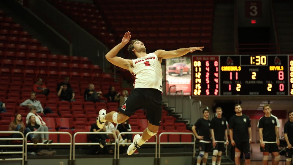 Senior outside attacker Blake Reardon jumps to serve the ball Jan. 11 in John E. Worthen Arena. Ball State defeated Queens, 3-0. Jacob Musselman, DN