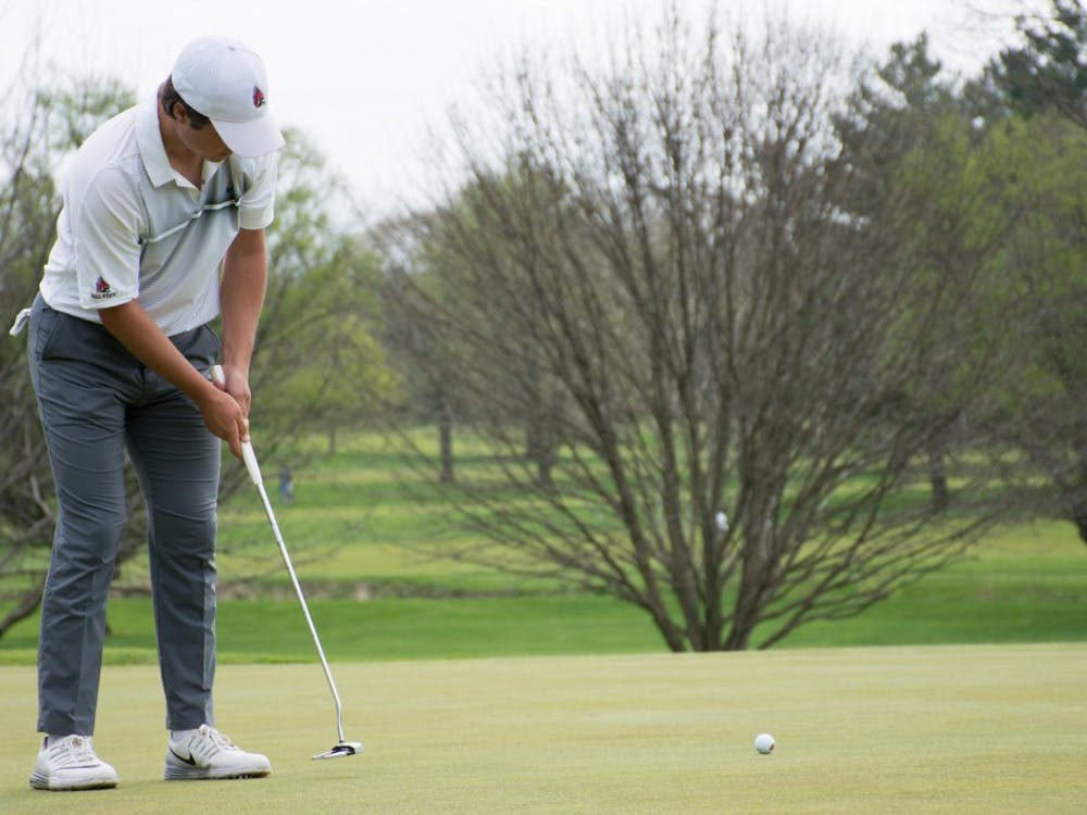 Junior Johnny Watts putts the ball during the Earl Yestingsmeier Memorial Invitational on April 14 at the Deleware Country Club.  Ball State scored 720, just behind Eastern Kentucky (714). Kaiti Sullivan // DN