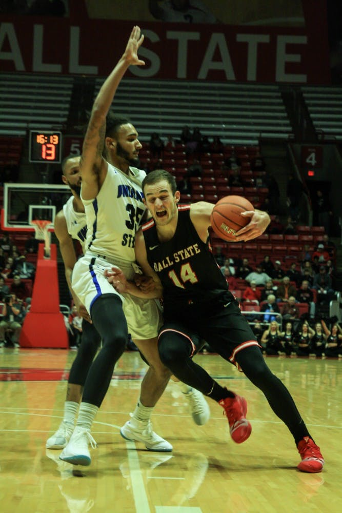 Indiana State center Devin Thomas guards forawrd Kyle Mallers as he heads towards the net at the Ball State men's basketball game versus Indiana State Nov. 6, 2018 in John E. Worthen Arena. Mallers had a total playing time of 28 minutes. Tailiyah Johnson,DN