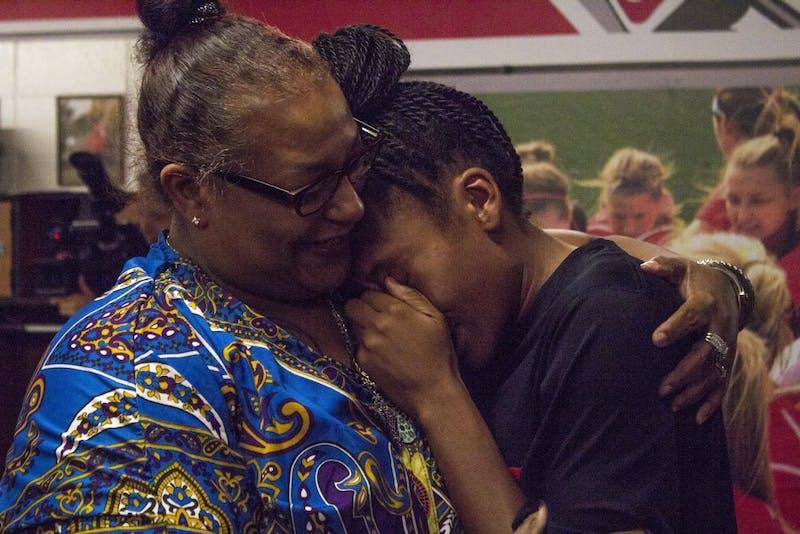 Senior defender Lorina White surprised by mother for Senior Day
