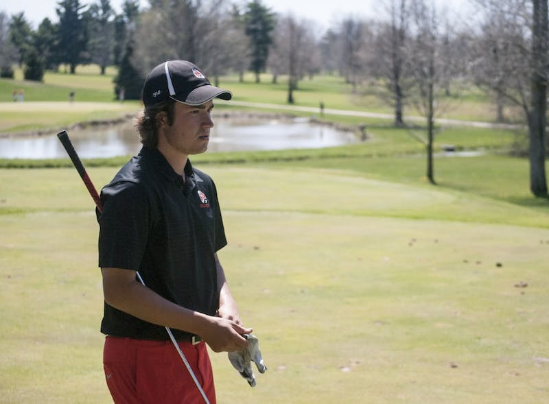 Sophomore golfer Johnny Watts gets ready to tee off on the par-3 16th hole at Delaware Country Club in the Earl Yestingsmeier Invitational. Watts finished the tournament in a three-way tie for the second place while the Cardinals won the team title. DN PHOTO COLIN GRYLLS
