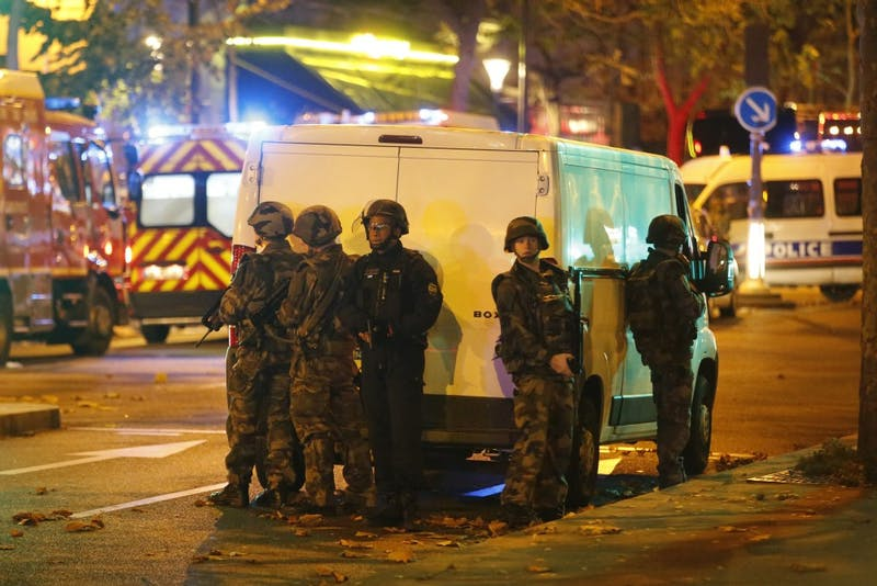 Security forces and police outside the Bataclan concert hall in central Paris as people are being held hostage on Friday, Nov. 13, 2015. After clearing the hall of attackers, officials reportedly found more than 100 dead inside. (Olivier Corsan/Maxppp/Zuma Press/TNS)