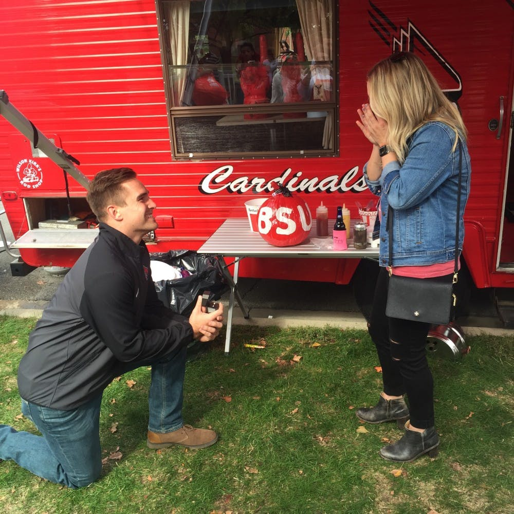 <p>Former Ball State football captain Ben Ingle proposes to Anna Phares before the Cardinals' Homecoming game on Saturday, Oct. 21. Ingle and Phares, who both graduated from Ball State in December 2015, met in Dr. Ronald Truelove's psychology class. Ben Ingle, photo provided.</p>