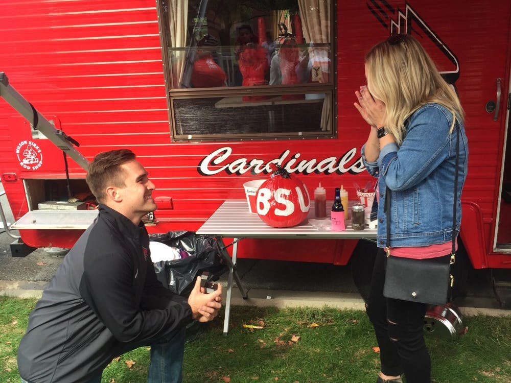 Former Ball State football captain Ben Ingle proposes to Anna Phares before the Cardinals' Homecoming game on Saturday, Oct. 21. Ingle and Phares, who both graduated from Ball State in December 2015, met in Dr. Ronald Truelove's psychology class. Ben Ingle, photo provided.