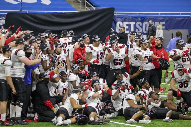 The Ball State Cardinals pose for a celebration picture after beating the University at Buffalo 38-28 in the Mid American Conference Championship Dec. 18, 2020, at Ford Field in Detroit, Mich. Jacob Musselman, DN
