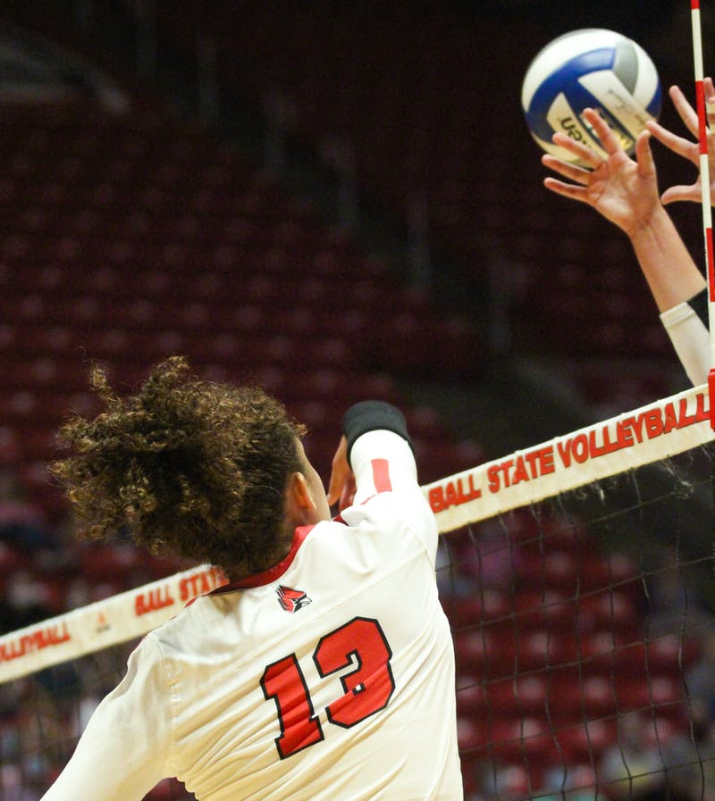 Junior outside hitter Natalie Mitchem spikes the ball past Northern Kentucky's blockers in Worthen Arena Sept. 18. The Cardinals beat out Northern Kentucky in 5 sets in the final game of the double header. Jacy Bradley, DN