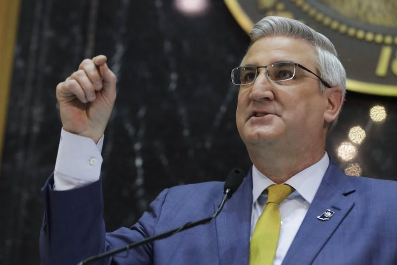 Indiana Gov. Eric Holcomb delivers his State of the State address to a joint session of the legislature at the Statehouse, Tuesday, Jan. 14, 2020, in Indianapolis. (AP Photo/Darron Cummings)