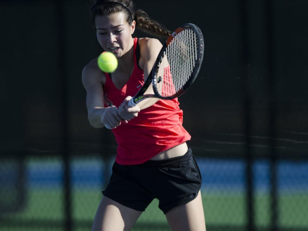 Sophomore Audrey Berger hits a backhand during her match against IUPUI on Feb. 19. Emma Rogers // DN