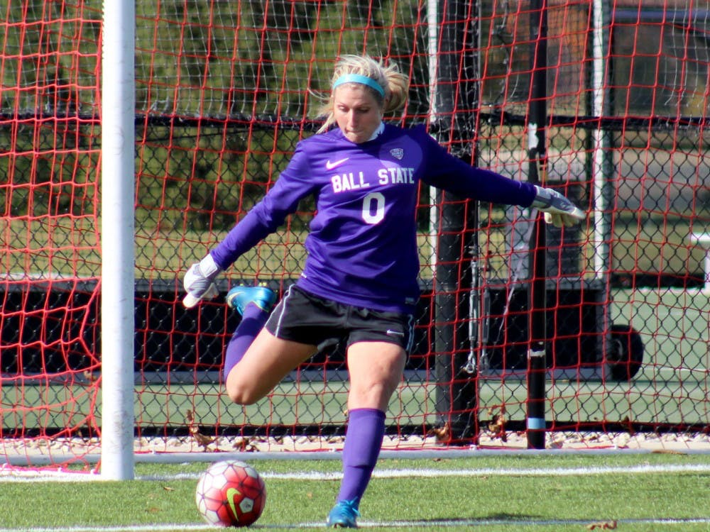 Sophomore goalie Alyssa Heintschel  attempts to kick the ball into the field in the match against Buffalo on Oct. 25 at the Briner Sports Complex. DN PHOTO ALLYE CLAYTON