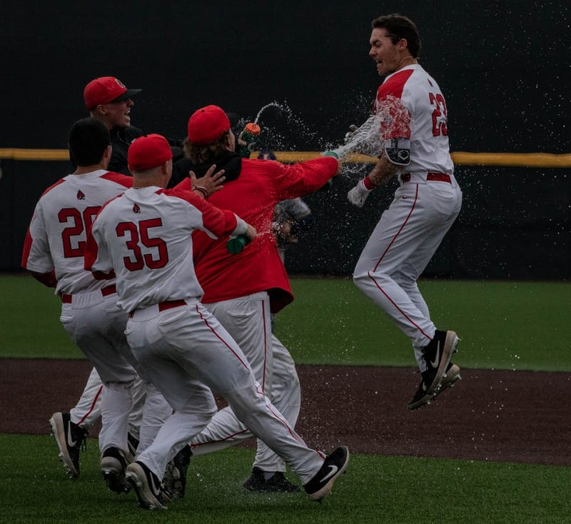 The Cardinals rush the field to meet Ross Messina after his hit that got the runner home to take the win over Kent State, March 31, 2019, at Ball Diamond at First Merchants Ball Park Complex. The game went 13 innings before the Cardinals came out on top 9-8. Rebecca Slezak,DN
