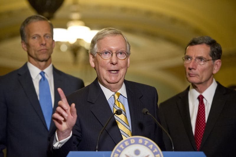 Senate Majority Leader Mitch McConnell (R-Ky.) speaks to reporters following the Republican Party luncheon in the United States Capitol in Washington, D.C., on June 27, 2017. He's flanked by John Barrasso (R-Wyo.), left, and Sen. John Thune (R-SD). (Ron Sachs/CNP/Sipa USA/TNS)