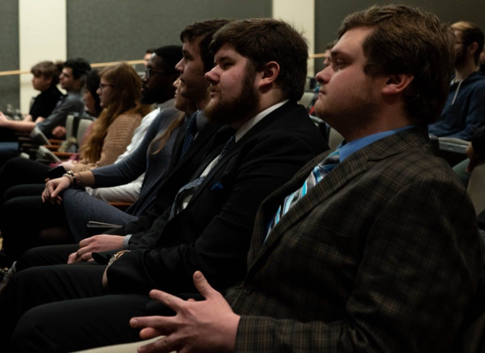 Jake Biller, presidential candidate for the United slate, and Andy Hoffman, campaign manager for the United slate, listen to a speaker Feb. 12, 2019 during the Student Government Association nomination convention in the Arts and Journalism building.  United was one of the three slates nominated. Scott Fleener, DN